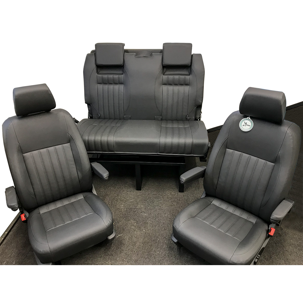 2 Single Front Seats with Arm and Head Rests with a 3/4 Rib Bed